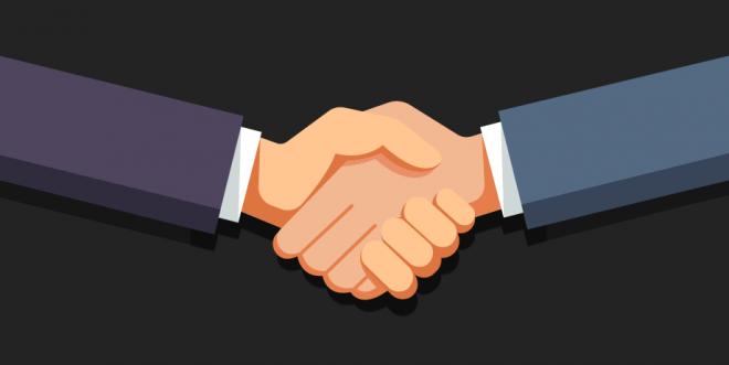 Aperto de mãos para simbolizar a associação da DTCOM à ACATE